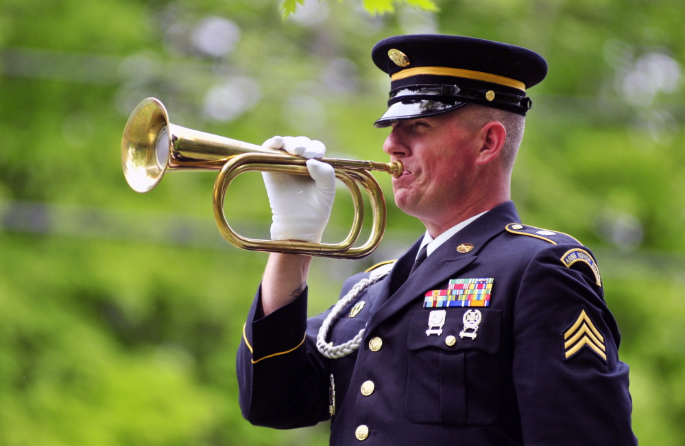 """Sgt. David Chabe plays """"Taps"""" during Memorial Day ceremonies honoring 44 Civil War veterans at Chelsea's Riverside Cemetery on Monday."""