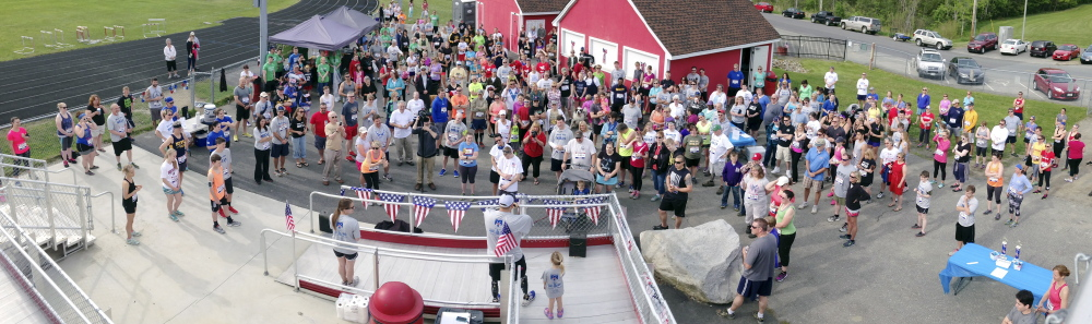 Travis Mills speaks to almost 300 participants before the 4th annual Miles for Mills 5k on Monday at Cony High School in Augusta. Proceeds from the event will benefit the Travis Mills Foundation, a nonprofit organization formed to benefit and assist wounded and injured veterans. Retired U.S. Army Staff Sergeant Travis Mills, of the 82nd Airborne, lost portions of both arms and legs from an IED while on active duty in Afghanistan and now lives in Manchester.