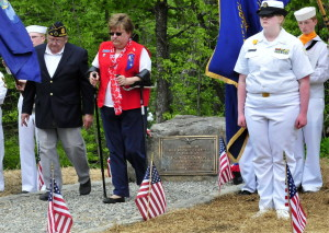 Earl Beaulieu and Robin Turek walk away after placing a wreath at the new Joseph Quirion Jr. war memorial created at the site of the former East Madison store on Monday.