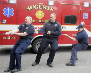 Augusta Fire Department paramedics Randy Gordon, left, Jeremy Manzer and Kurt Gordon get pulled inside Hartford Fire Station in Augusta by colleagues during training last week. The Department is celebrating 40 years of providing emergency medical services in the community. The course, taught by Randy Gordon, instructed paramedics on how to rescue the injured with ropes.
