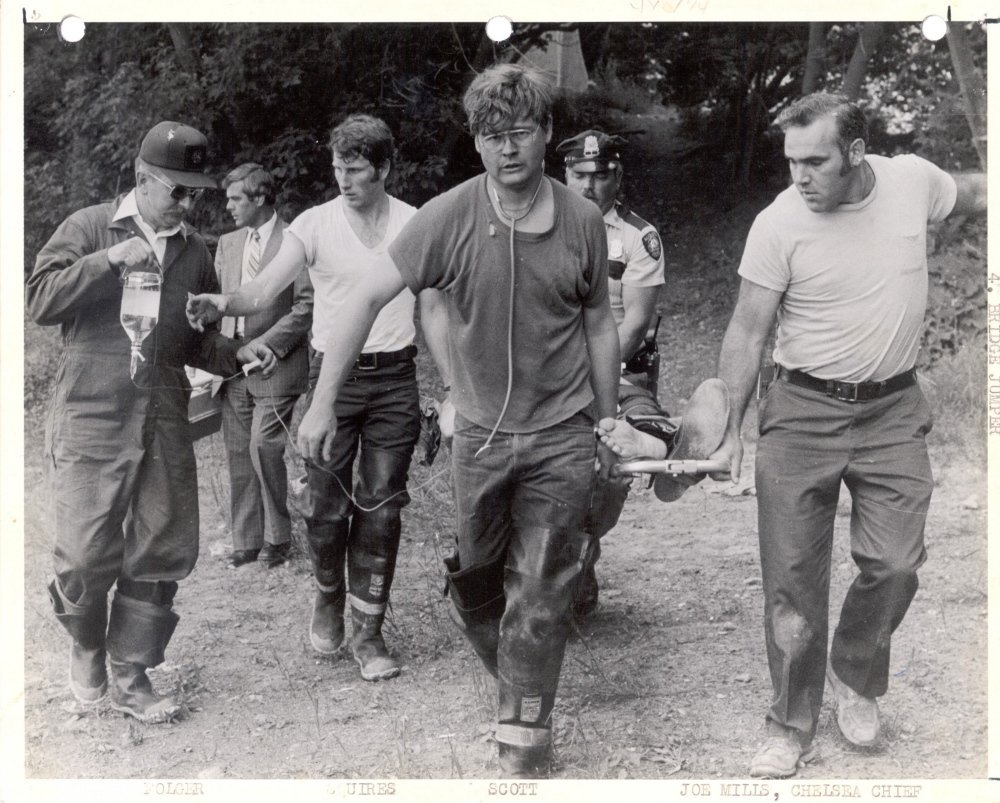 Augusta emergency services crews, including Charlie Squires on the left, transport a person who jumped off the Memorial Bridge in the early 1980s.