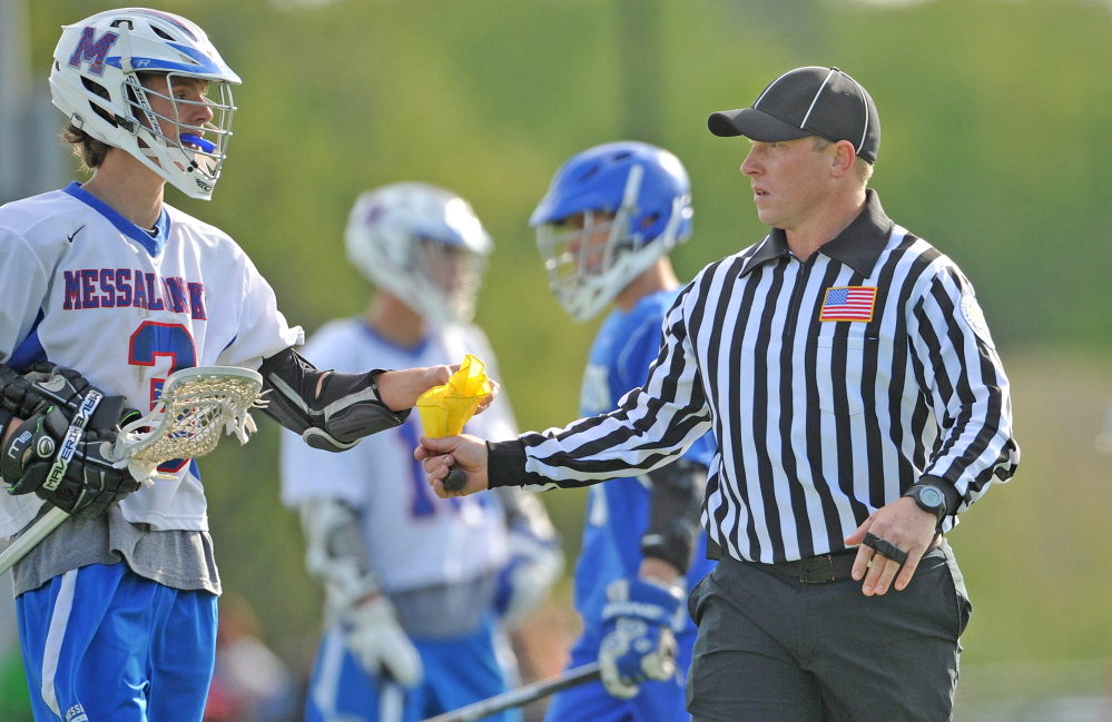 Josh Blaisdell officiates a high school lacrosse game last week at Thomas College in Waterville.