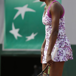 Venus Williams turns away after missing a return in the first round match of the French Open on Monday against Sloane Stephens at the Roland Garros stadium in Paris, France. Stephens beat Williams 7-6 (5), 6-1.