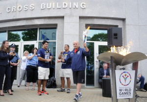 The torch is lit outside the State House in Augusta on Tuesday for the Special Olympics for the first leg of the Law Enforcement Torch Run during a kickoff event.