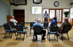 Leo Maheu, environmental educator for ecomaine, gives a presentation to attendees Tuesday at The Center in Waterville.