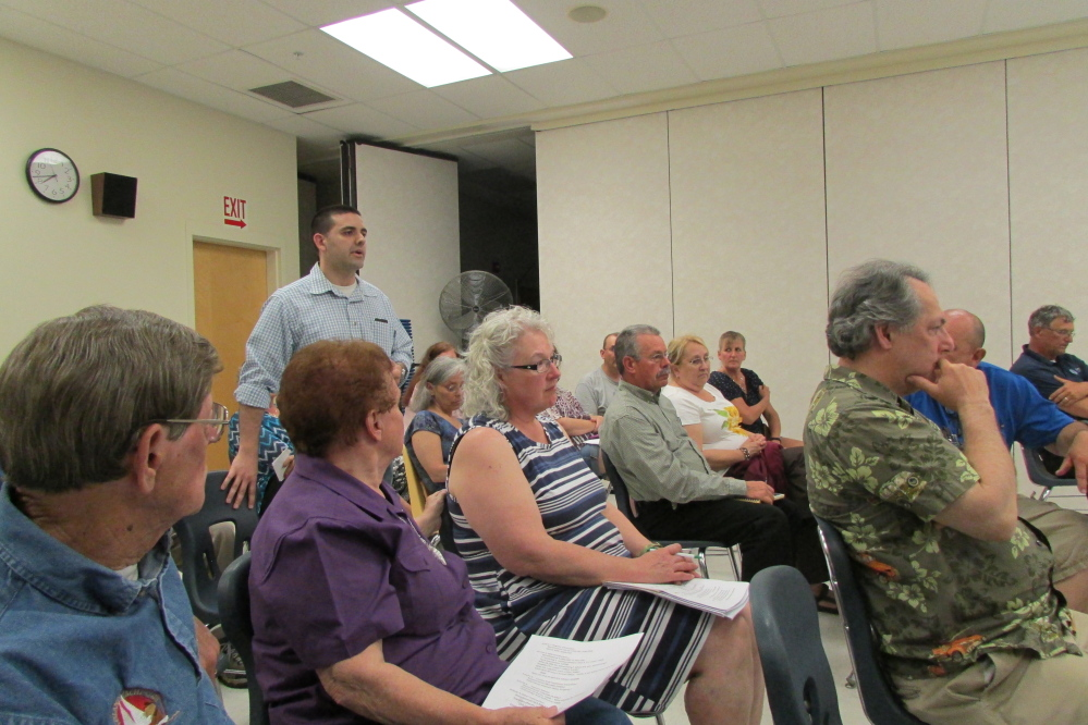 Fairfield Town Manager Josh Reny addresses the SAD 49 school board at an informational session Tuesday evening at Lawrence Junior High School. The board is considering cuts to a $25.9 million budget that was rejected by voters in a referendum vote May 19.