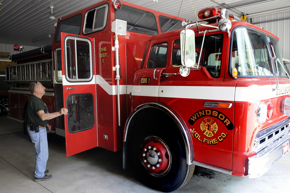 WINDSOR, ME - MAY 26: Windsor Fire Chief Arthur Strout opens Tuesday May 26, 2015 the door on the 29-year-old engine he hopes residents will vote to replace. (Kennebec Journal photo by Andy Molloy/Staff Photographer)