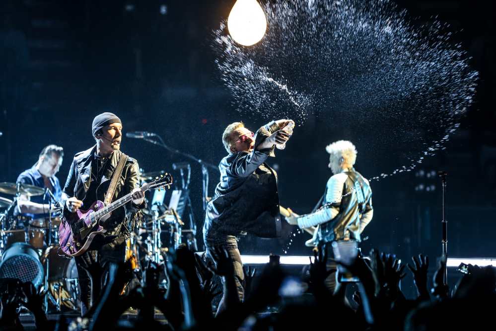 Larry Mullen Jr., from left, The Edge, Bono and Adam Clayton of U2 perform at the Innocence + Experience Tour at The Forum on Tuesday in Inglewood, Calif.