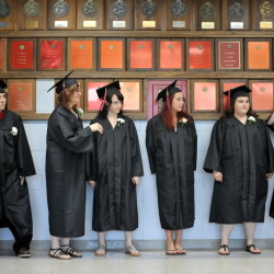 Graduates of the Mid Maine Adult Community Education program wait in the halls at Waterville Senior High School for graduation ceremonies to begin on Tuesday.