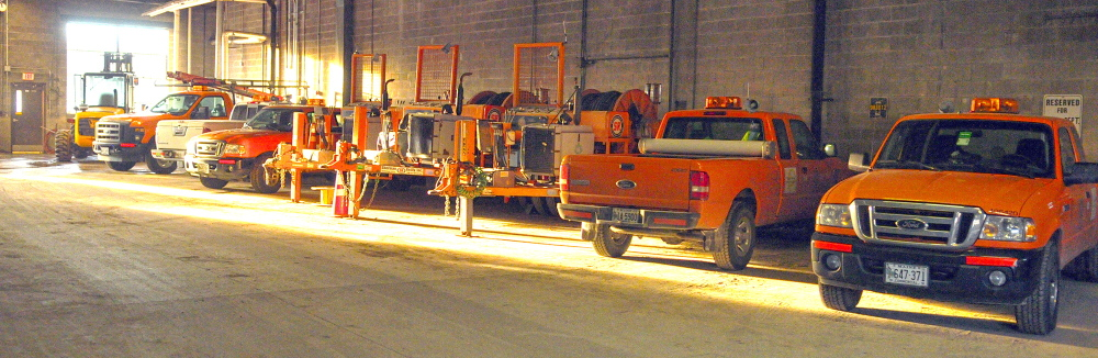 Rows of vehicles are parked last year at Central Maine Power Co.'s Augusta Service Building on Old Winthrop Road. A new law will change where utilities such as CMP pay excise taxes on their vehicles,from where their headquarters is located to where the vehicles are kept overnight.