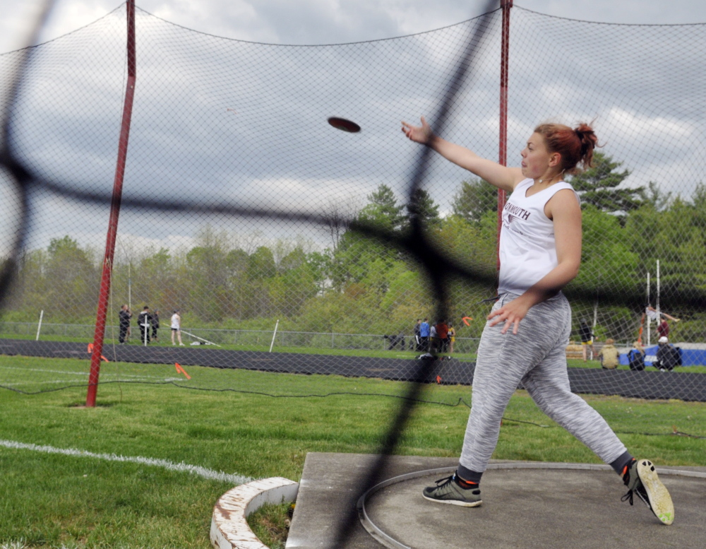Monmouth's Mahalia Hayden throws the discus during the annual Capital City Classic at Cony High School last Friday.