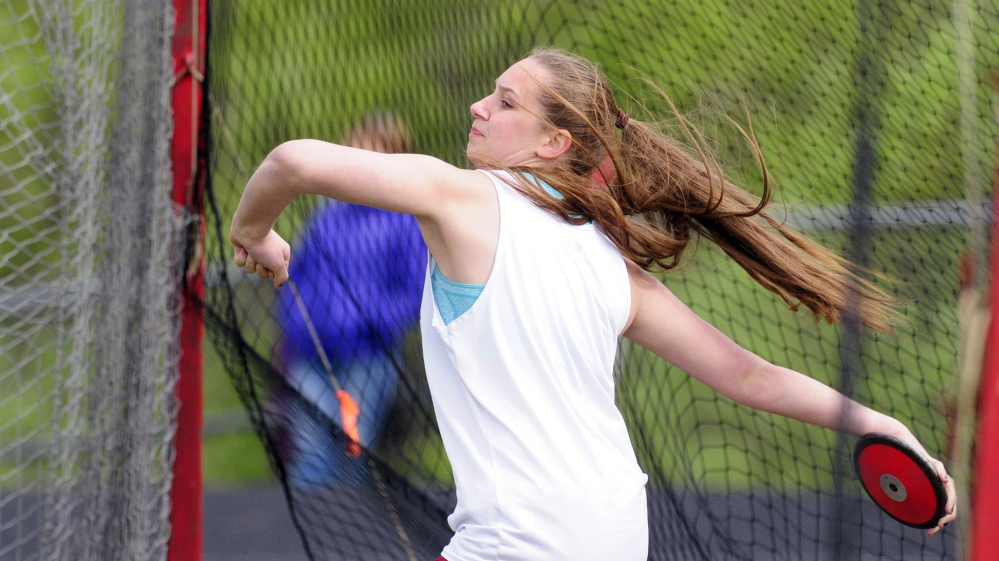 Monmouth's Maddie Amero heaves the discus during the Capital City Classic at Cony High last Friday.