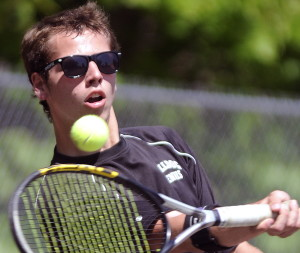 Hall-Dale High School's Bryson Camp returns a shot during a singles match against Boothbay in the Mountain Valley Conference championships Wednesday in Farmingdale.
