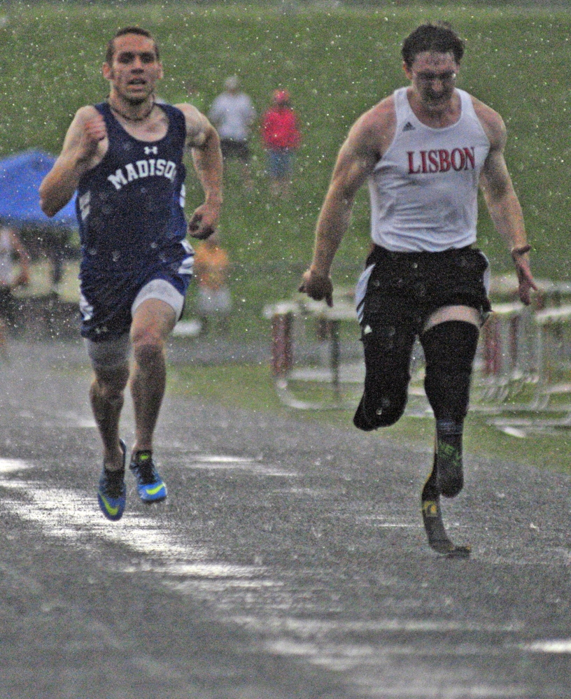 Madison's Matthew Curtis and Lisbon's Nicholas Rogers run the 100-meter dash final during the Mountain Valley Conference championship meet Thursday at Alumni Field at Cony High School in Augusta.