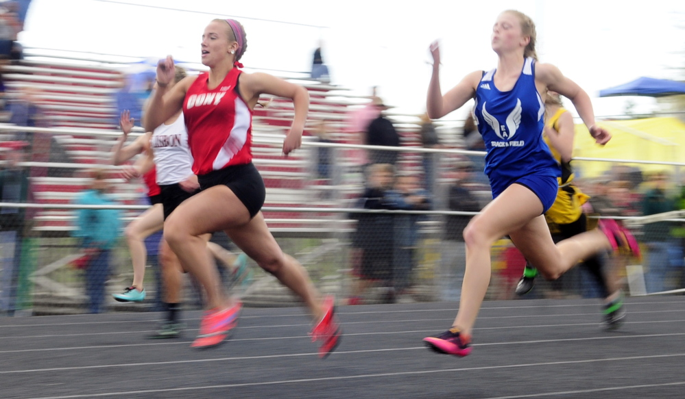 Cony's Madeline Reny, left, leads Erskine Academy's Jordan Jowett on way to winning the 100 meters during the Capital City Classic last week at Cony High School in Augusta.