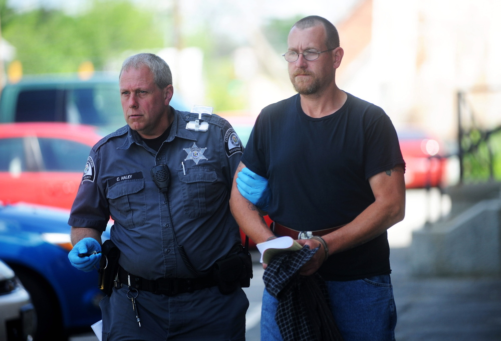 Mark Bussell is escorted Friday from Somerset County Superior Court in Skowhegan by Correctional Officer Charles Haley to a transport vehicle bound for the Somerset County jail, where he will await transfer to state prison to serve his sentence for a manslaughter conviction.