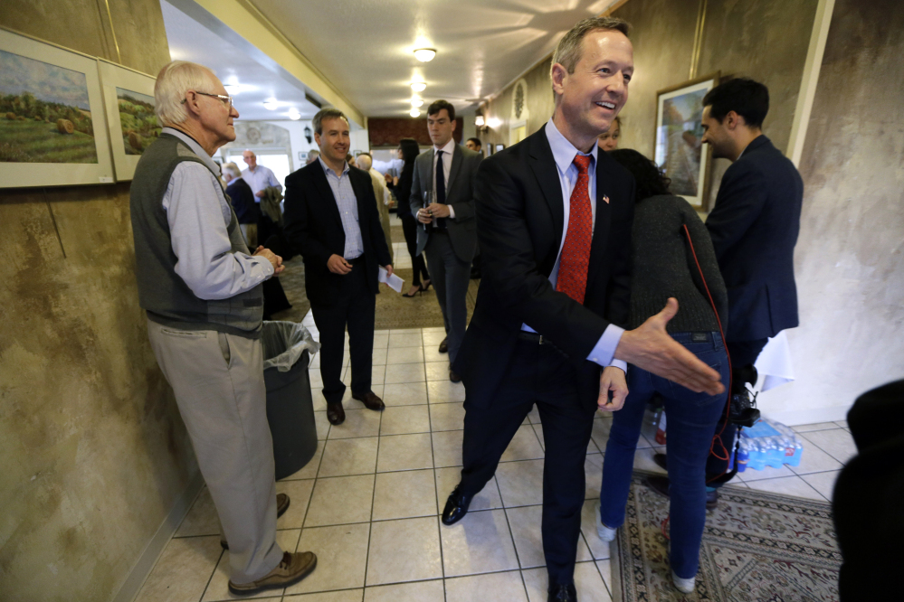 In this April 9, 2015 file photo, former Maryland Gov. Martin O'Malley greets local residents before speaking at a fundraiser in Indianola, Iowa.