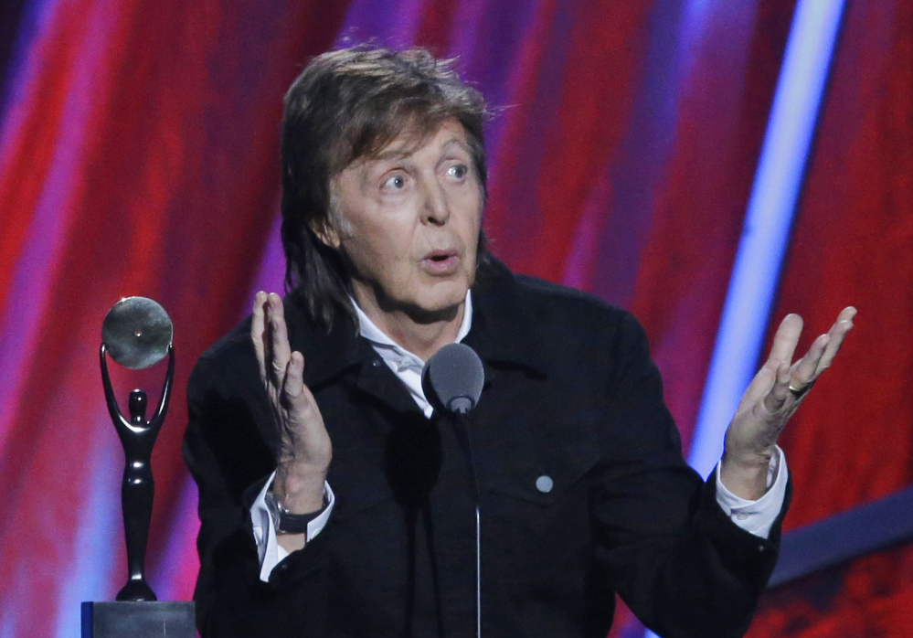In this file photo dated Sunday April 19, 2015, Paul McCartney introduces Ringo Starr at the Rock and Roll Hall of Fame induction ceremonies,  in Cleveland, USA.