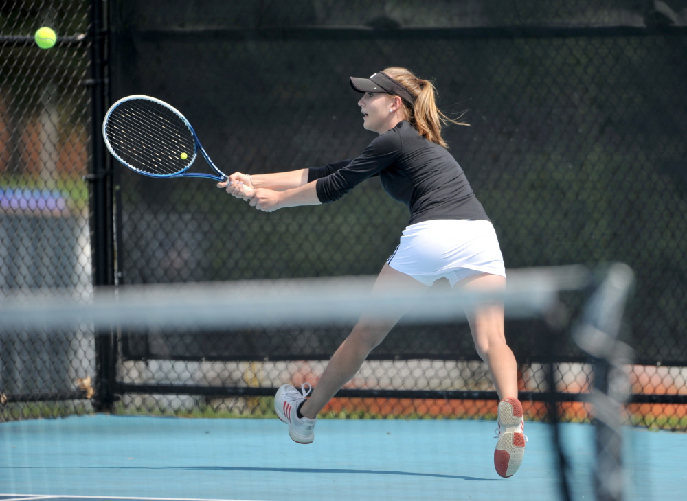 St. Dominic High School's Bethany Hammond competes Saturday against Cheverus High School's Natalia Mabor in the state singles championship Round of 16.