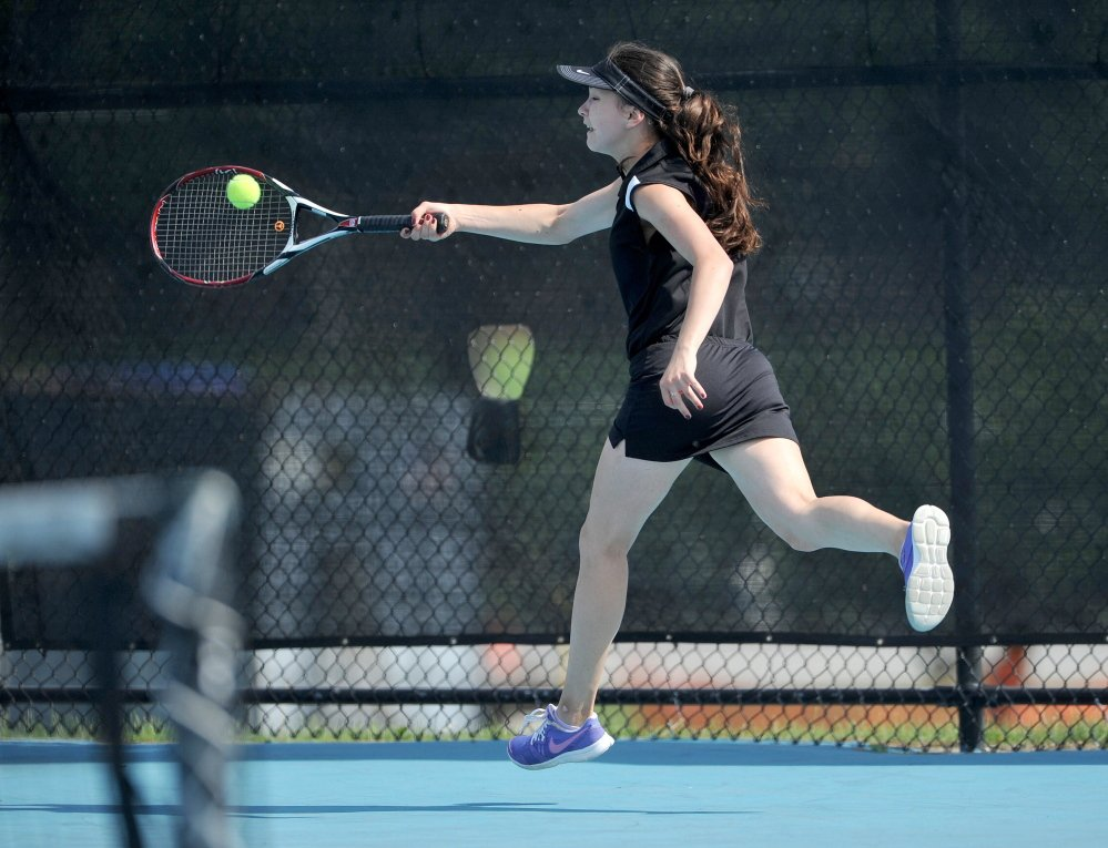 Skowhegan Area High School's Vasilisa Mitskevich competes Saturday against Greely High School's Izzy Evans in the state singles championship Round of 16.