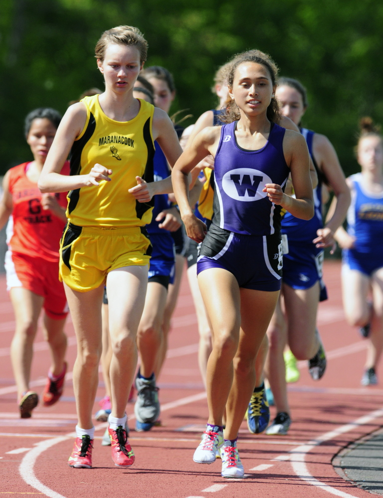 Maranacook's Hannah Despres, left, and Waterville's Cecilia Morin run the 3200 meters Saturday during the KVAC track meet at McCann Field in Bath.