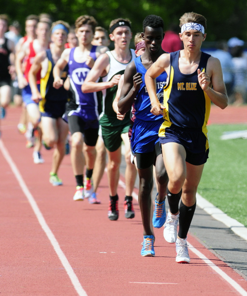 Mount Blue's Aaron Willingham leads the 3200 meters Saturday during the KVAC track meet in Bath.