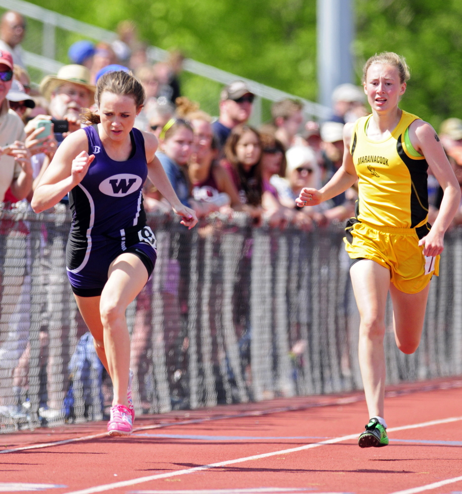Waterville's Amy Samson, left, and Maranacook's Lindsay Perkins run the 200 meter dash Saturday during the KVAC track meet in Bath.