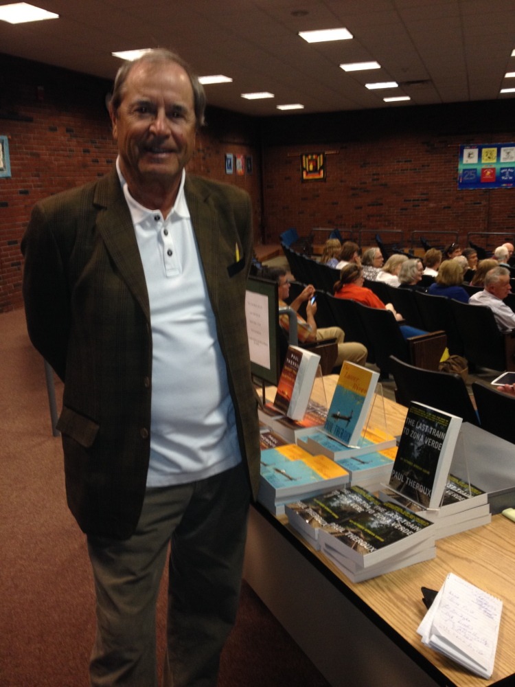 Author Paul Theroux prepares to speak to an audience Saturday at the University of Maine at Augusta's Jewett Hall about several of his books on the table next to him. Theroux's presentation capped off Lithgow Public Library's A Capital Read 2015 program.