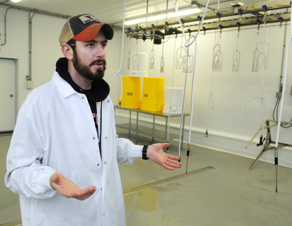 Ryan Wilson leads a tour March 5 at Common Wealth Poultry Co. in Gardiner.