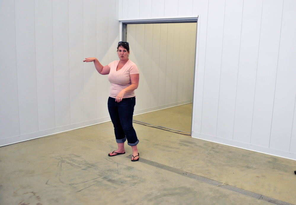 Financial administrator Jennifer Wade leads a tour on Friday of the Central Maine Meats slaughterhouse in Gardiner's Libby Hill Business Park.