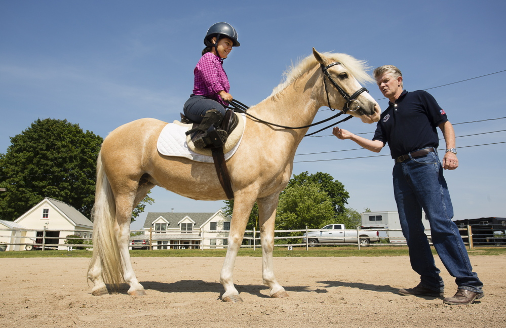 A para-driving champion from South Carolina, Meghan Benge says the Para-Equestrian Pipeline Training Camp in Lyman may have given her enough confidence to consider competitive para-dressage. Here she receives coaching Saturday from Kai Handt, the U.S. Paralympics Equestrian team coach.