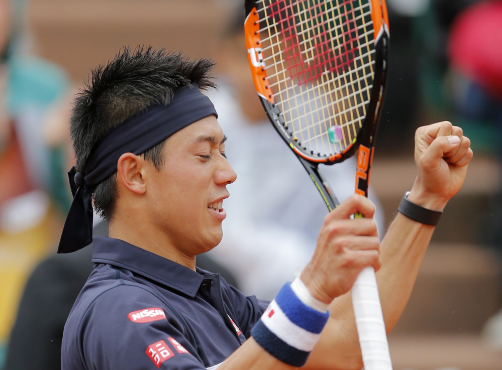 Japan's Kei Nishikori reacts after defeating Russia's Teymuraz Gabashvili during their fourth round match of the French Open tennis tournament at the Roland Garros stadium, Sunday in Paris.
