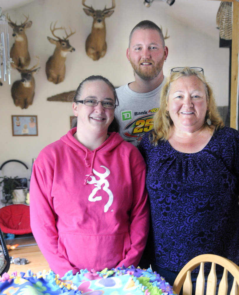 Judy Wildes, right, with her son, Derek Wildes, and his girlfriend, Erica Rollins, at the elder Wildes Augusta home on Sunday. Rollins and Derek Wildes' son, Mason, was born prematurely and is being treated at Maine Medical Center in Portland.