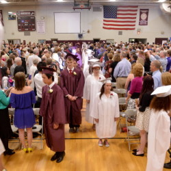 Maine Central Institute's class of 2015 march into the gymnasium during commencement ceremonies at Maine Central Institute in Pittsfield on Sunday.