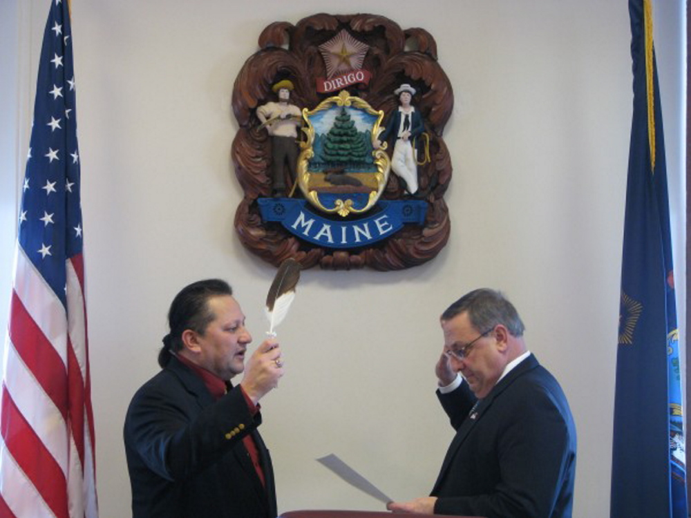 Maliseet tribal Rep. Henry Bear, left, has sponsored a bill in the Legislature that would add a constitutional amendment referendum question on the ballot this November, asking Maine voters if they wish to repeal the printing ban on redacted constitutional language in Article X, Section 5 of the Maine Constitution. At right is Gov. Paul LePage.
