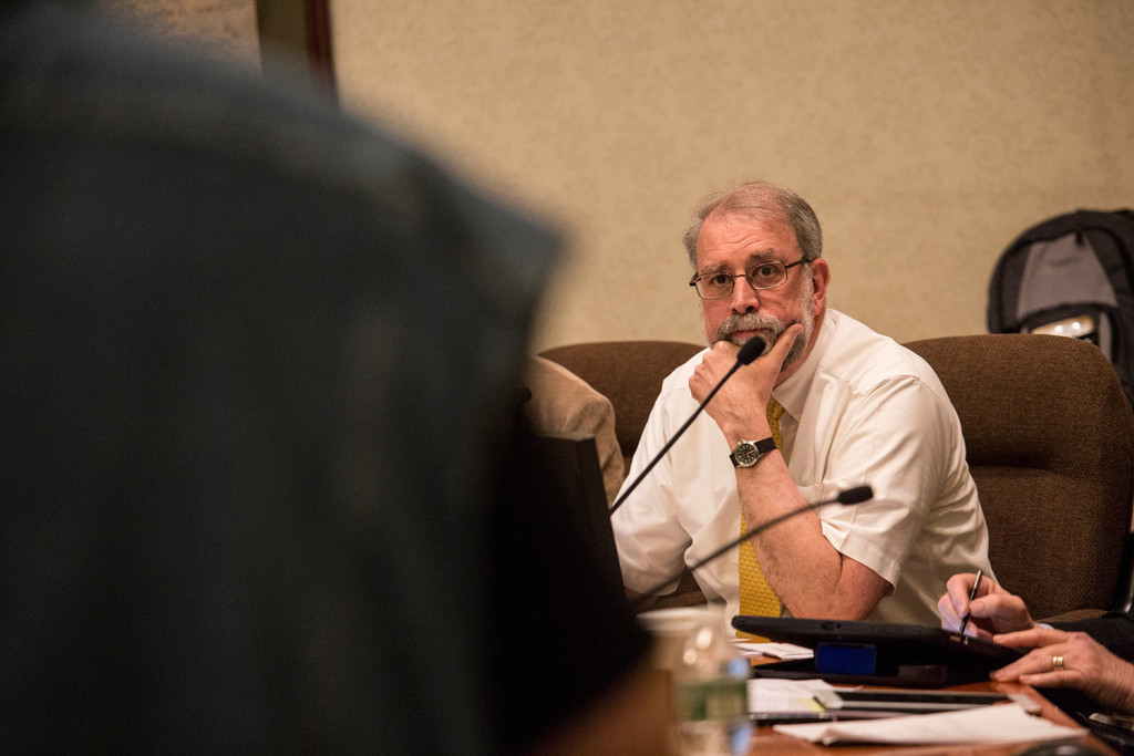 Mayor Alan Casavant listens to public comment at Tuesday night's Biddeford City Council meeting. He told the standing-room-only audience that city officials cannot comment on the investigation of abuse allegations, but want to see justice.