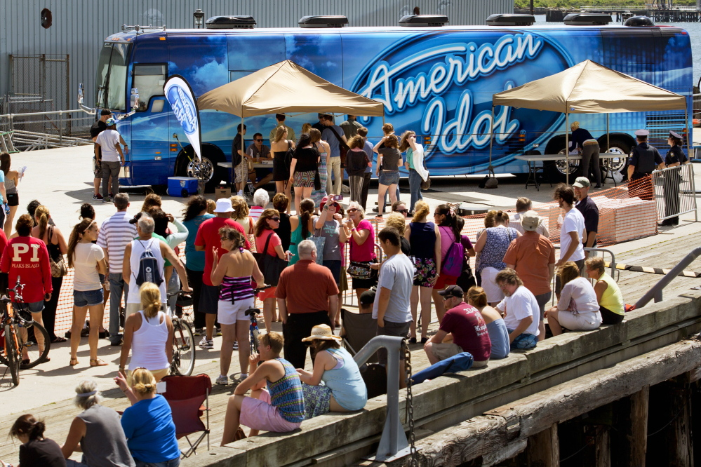 """People wait in line on the Maine State Pier in Portland to try out for """"American Idol."""""""