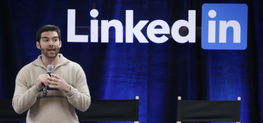CEO Jeff Weiner talks during a meeting at LinkedIn offices. The company is feeling the impact of changes in currency exchange rates and the costs of acquiring Lynda.com.