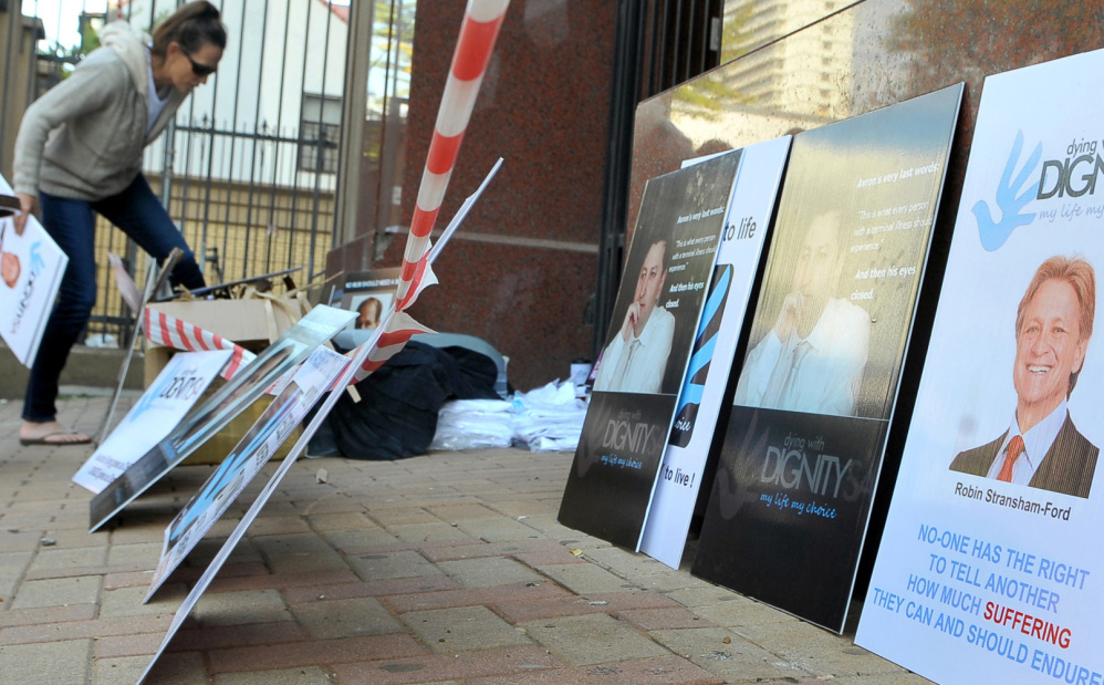 Placards are placed outside the high court in Pretoria, South Africa, where a euthanasia case was being heard.