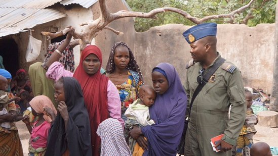 A Nigerian army soldier talks with hostage women and children who were freed from Boko Haram on Wednesday. Nigeria's military rescued another set of women and children who had been kidnapped by Boko Haram militia and were being detained in the Sambisa forest where the Islamist group has been holed up, an army spokesman said Thursday.