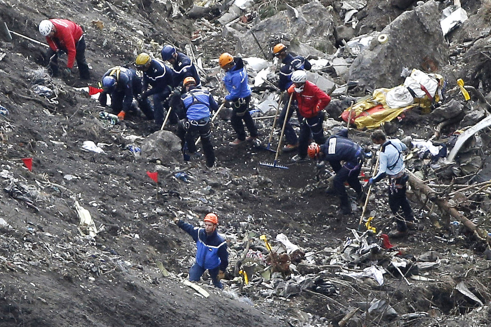 In this March 26, 2015 file photo, rescue workers work on debris of the Germanwings jet at the crash site near Seyne-les-Alpes, France.