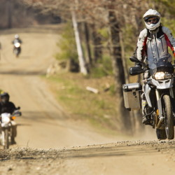 Members of the Maine Dual Sport & Dirt Bike Association, who ride bikes with both ATV and motorcycle registrations, explore a dirt road near Whitefield.