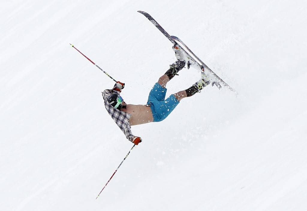 """Keith Moffat, 24, of Squaw Valley, Calif., flips down the slope after skiing off a cliff at Tuckerman Ravine on Mount Washington. """"I misjudged the softness and stickiness of the landing, and had a nice tomahawk down the ravine,"""" he said.  The Associated Press"""