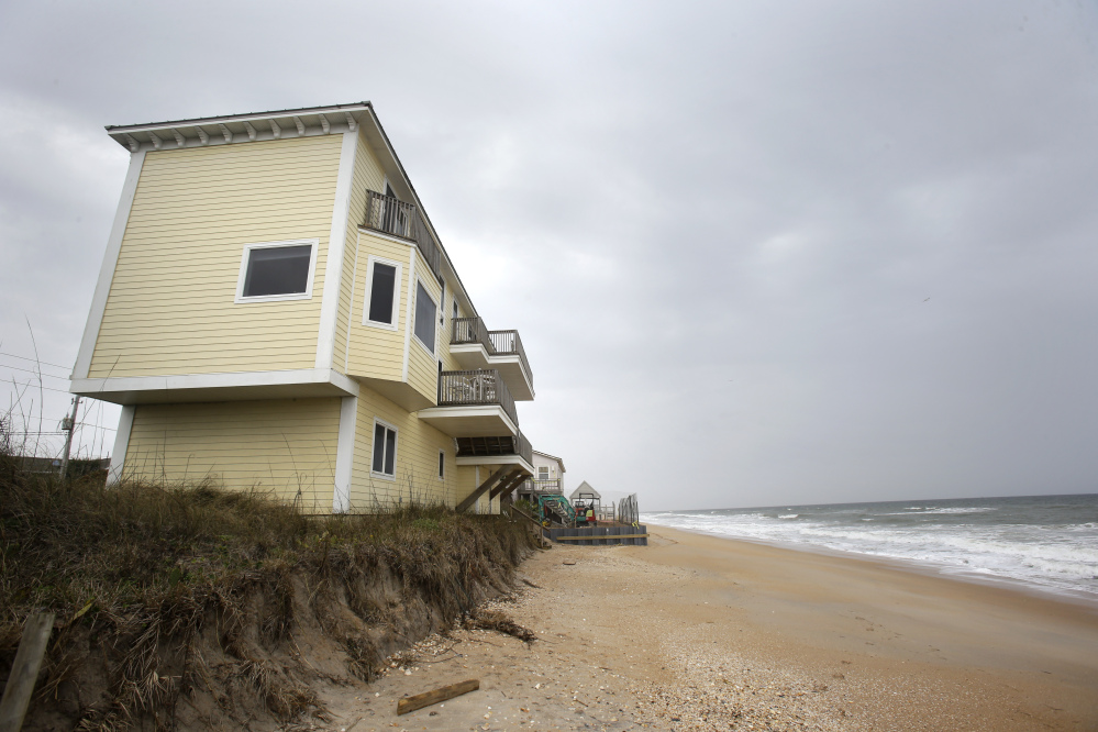 """Beach erosion threatens homes, photographed in February at Vilano Beach in St. Augustine, one of many chronically flooded communities along Florida's coast. The state is offering """"no guidance'"""" an engineer says."""