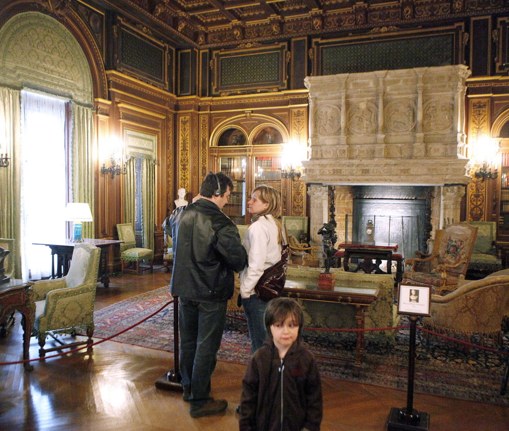 """Visitors view the library of The Breakers, a 70-room Vanderbilt family summer estate in Newport, R.I. The Newport Preservation Society's chairman says objects donated by Vanderbilt family members who criticize the management of the mansion are not """"highly significant."""""""