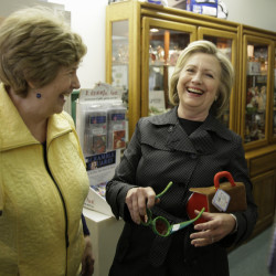 Hillary Rodham Clinton visits a toy shop in Independence, Iowa, on Tuesday. She urged the State Department to release 55,000 pages of her emails.