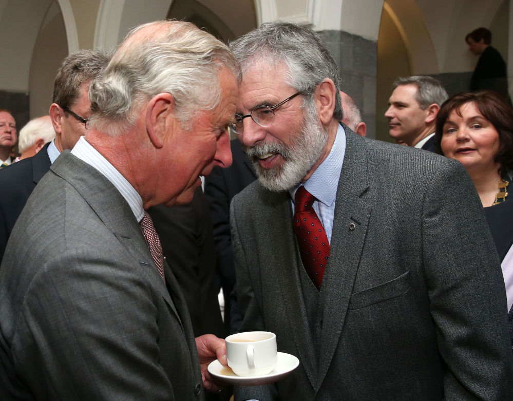 Britain's Prince Charles  shakes hands with Sinn Fein President Gerry Adams at the National University of Ireland in Ireland on Tuesday.