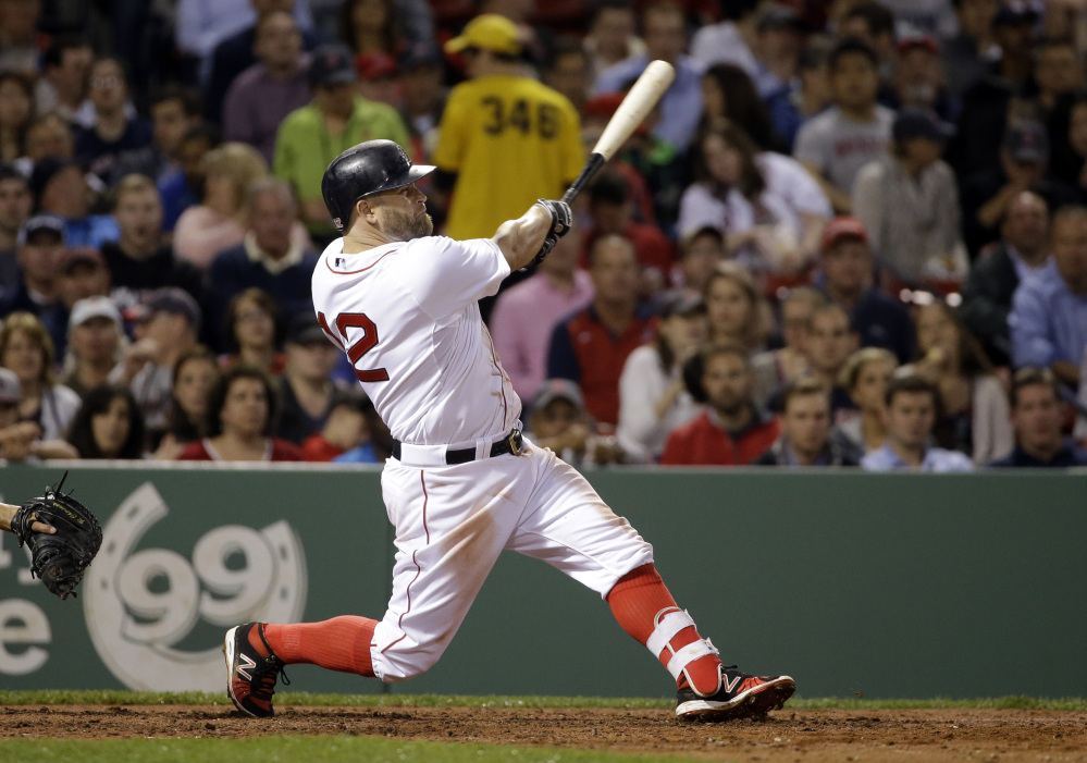 Boston's Mike Napoli hits a solo homer in the fourth inning Tuesday night, his fourth home run of the season.