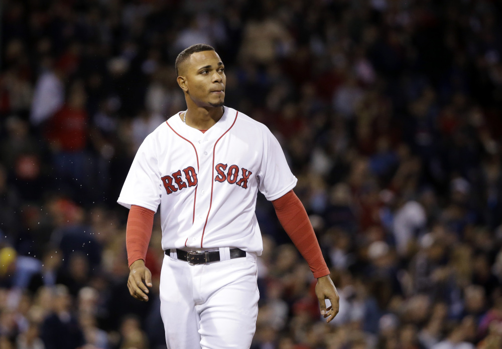 Boston's Xander Bogaerts watches the replay after lining out with the bases loaded to end the sixth inning of Wednesday night's game at Fenway Park. The Red Sox left 12 runners on base in the 2-1 loss to the Texas Rangers.