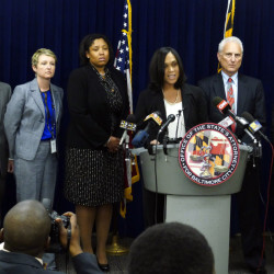 Baltimore States Attorney Marilyn Mosby, center, announces the indictments of six Baltimore police officers Thursday on various charges related to the arrest and death of Freddie Gray.